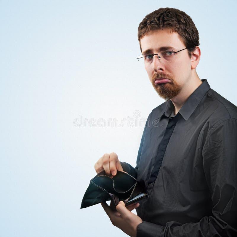 Bröt plånboken för visningen för affärsmannen med inga pengar royaltyfria bilder