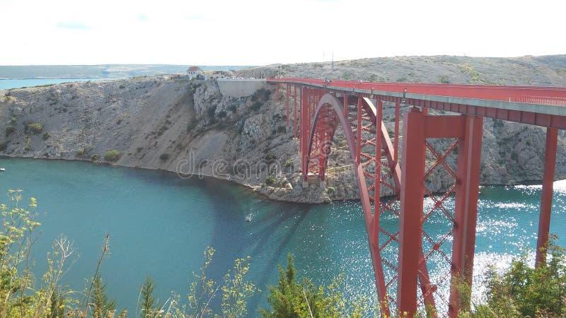 Brücke über Meer stockbild