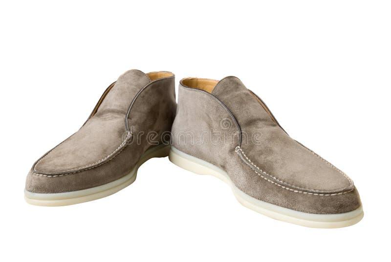 brąz odizolowywający skóry światła męscy buty biały fotografia stock
