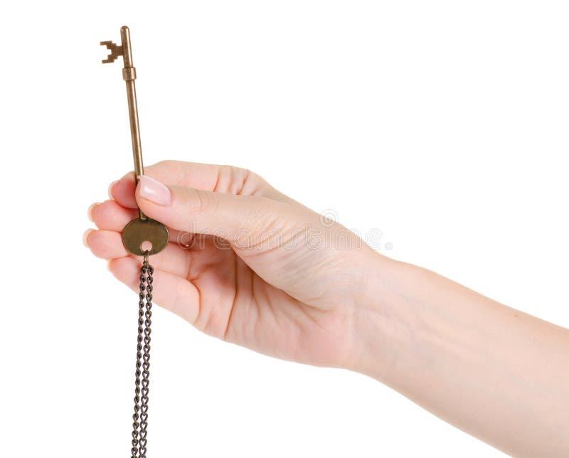 Brązowy klucz w ręce fotografia stock