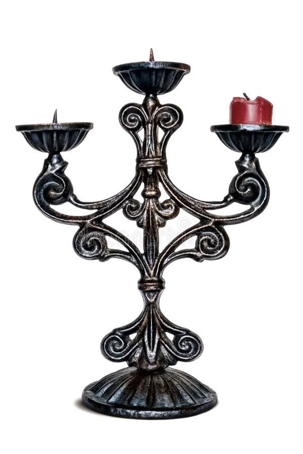 Brązowy trójgłowy stary candlestick z świeczką czerwona świeczka zdjęcia stock