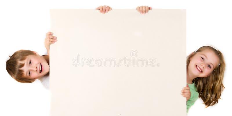 brädepojkeflicka fotografering för bildbyråer