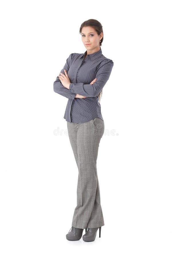 Braços eretos da mulher de negócios confiável cruzados fotografia de stock royalty free