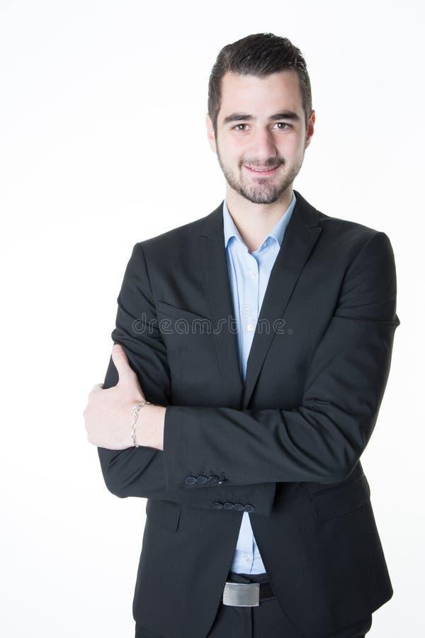 braços seguros de sorriso do retrato do homem de negócios cruzados fotos de stock