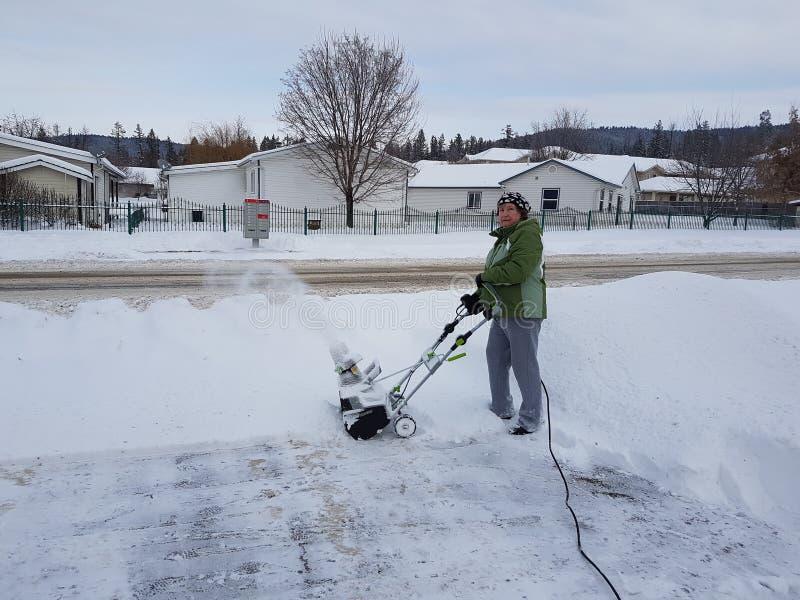 Brać śnieg zdala od domu zdjęcia royalty free