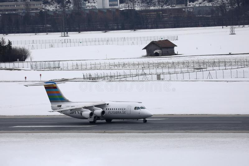 BRA Braathens Regional Airlines plane in Innsbruck Airport, snow. BRA Braathens Regional Airlines plane in Innsbruck Airport INN, snow on runway. Flygbras stock photography