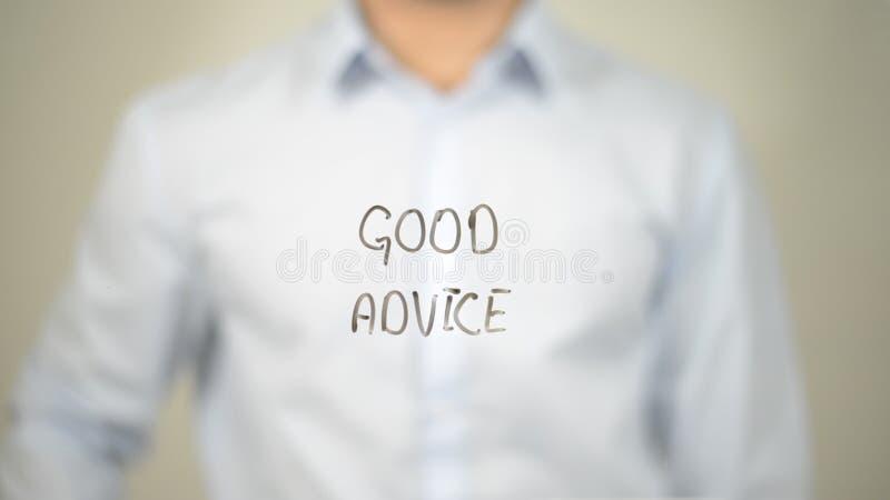 Bra rådgivning, manhandstil på den genomskinliga skärmen royaltyfria foton