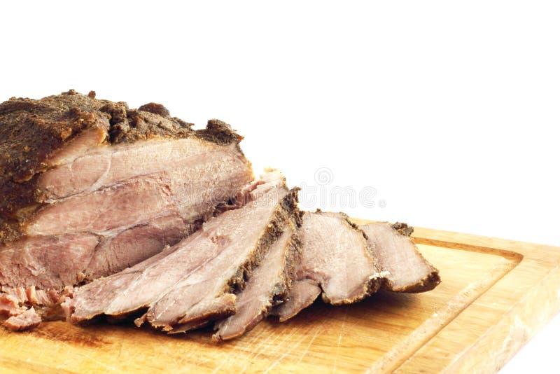 Braadstukvarkensvlees op een houten raad royalty-vrije stock fotografie