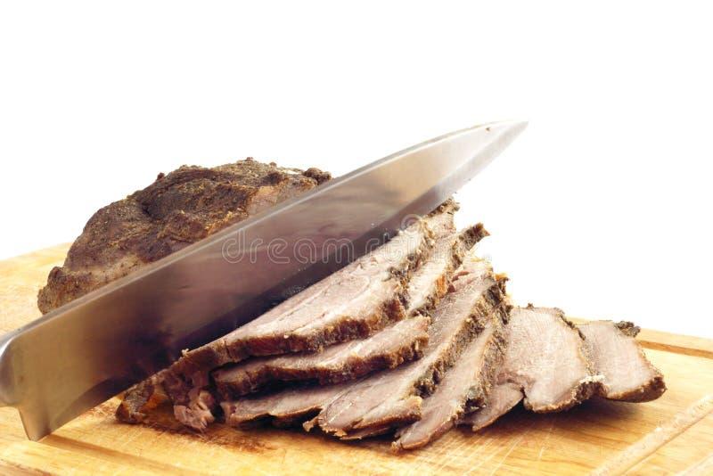 Braadstukvarkensvlees op een houten raad royalty-vrije stock foto's