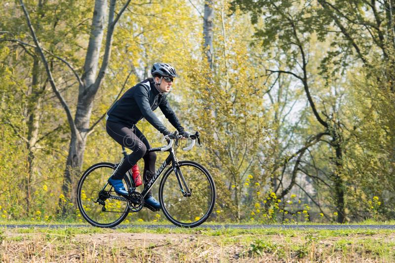 Cycle runner is training in nice spring weather, Brabant, Netherlands royalty free stock photos