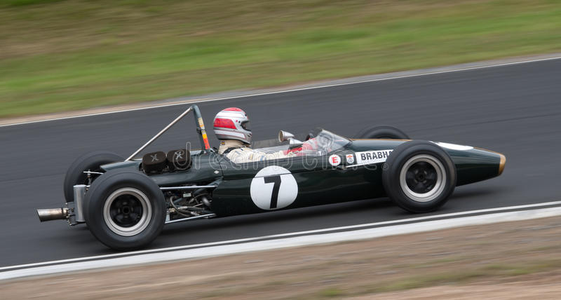 Brabham Formula One racing car at speed. Festival of Motorsport: Bruce McLaren's 1967 Brabham Formula One F1 race car competing in a Historics Revival Series stock photo
