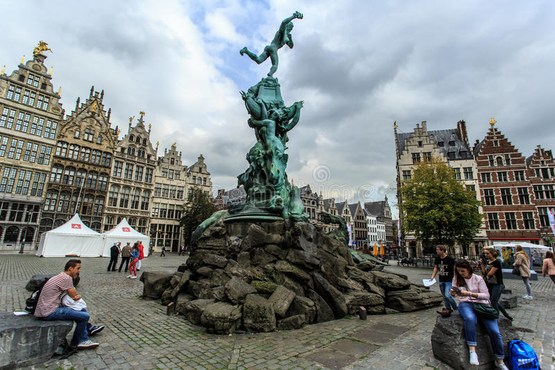 Brabo Fountain and sitting tourists at Grote Markt in Antwerp, Belgium royalty free stock photo