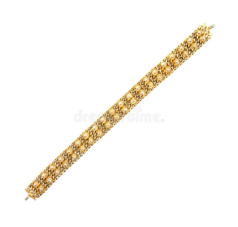 Braccialetto dell'oro Braccialetto del vecchio oro isolato su fondo bianco fotografie stock