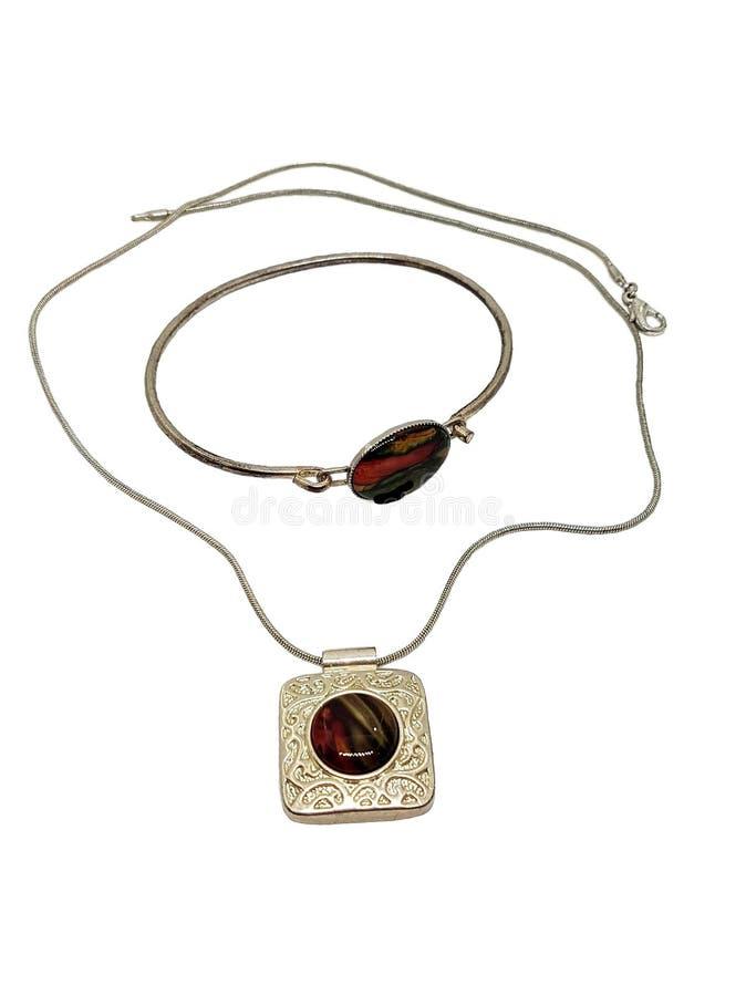 Braccialetto e catena con il pendente di argento fotografia stock
