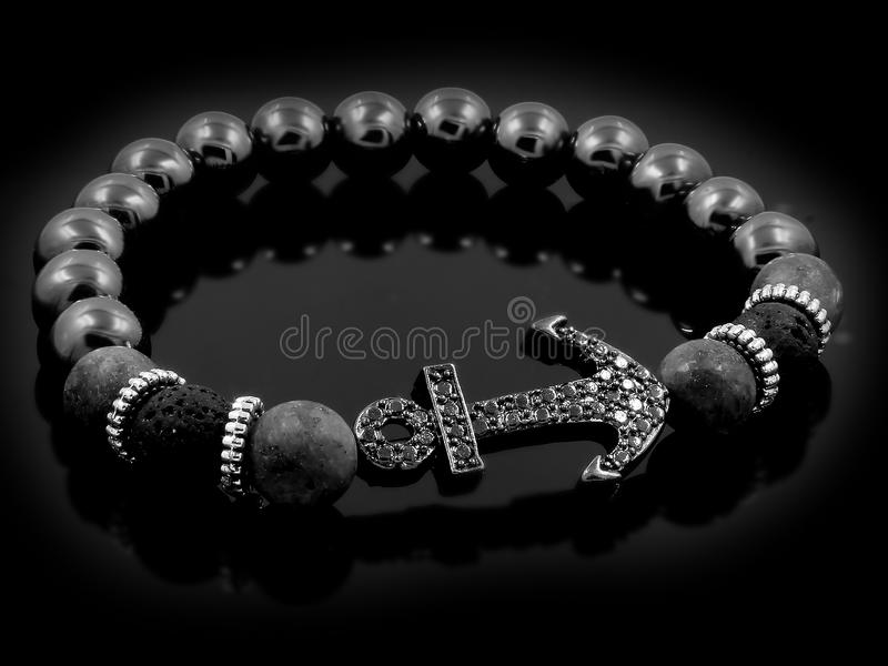 Braccialetto per gli uomini - Lava Balls Bijouterie dei gioielli fotografia stock libera da diritti
