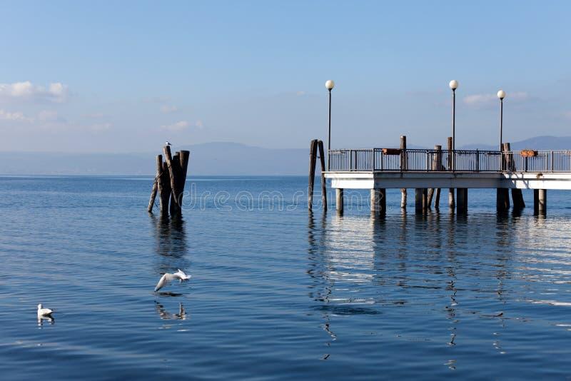 Bracciano Lake At Anguillara Sabazia. Tranquil morning on Bracciano Lake at Anguillara Sabazia, Lazio, Italy royalty free stock photo