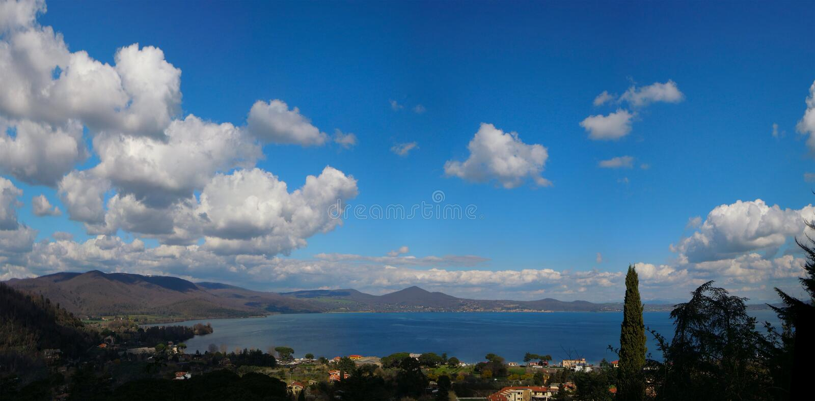 Bracciano lake in spring. A panoramic view of Bracciano lake, near Rome, Italy in a clear, sunny spring day royalty free stock image