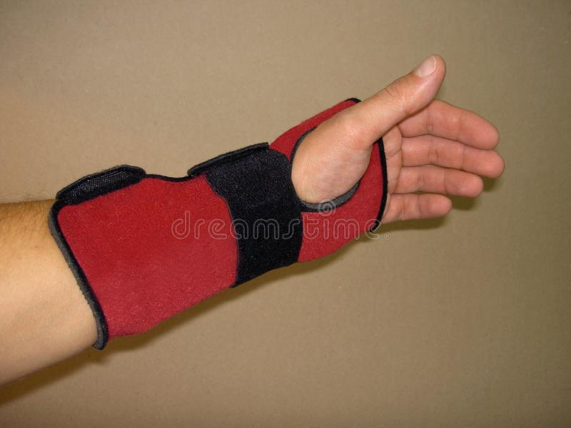 Brace red with black strap fasten on left hand royalty free stock images