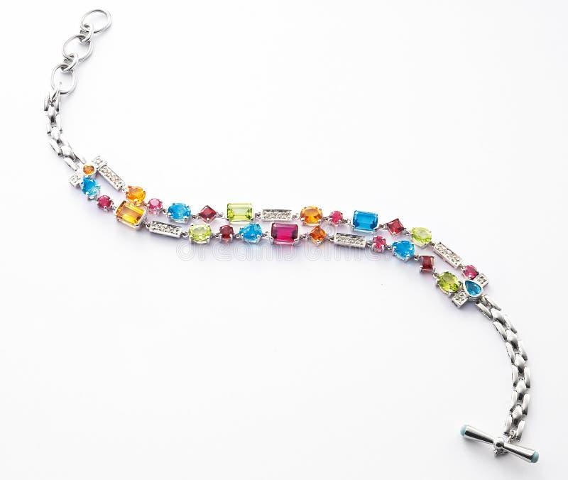Bracelet. A bracelet with many different types of gems stock photo