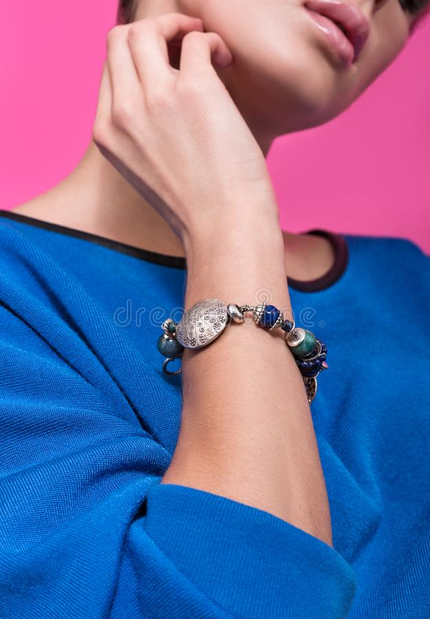 The bracelet on the arm of a young woman. Wrist bracelets are handmade royalty free stock photos