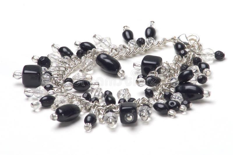 Bracelet avec les pierres noires photo libre de droits