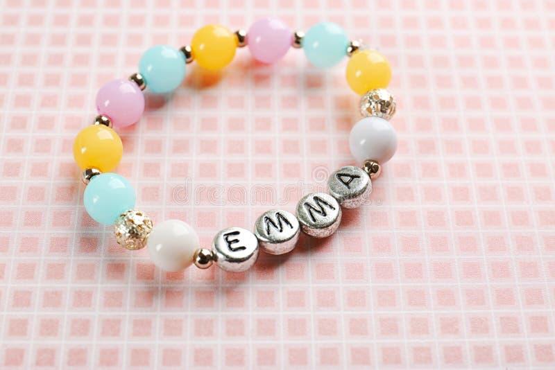 Bracelet with baby name EMMA royalty free stock photos
