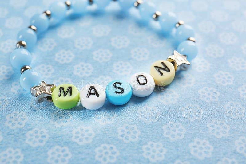 Bracelet with baby name MASON stock image