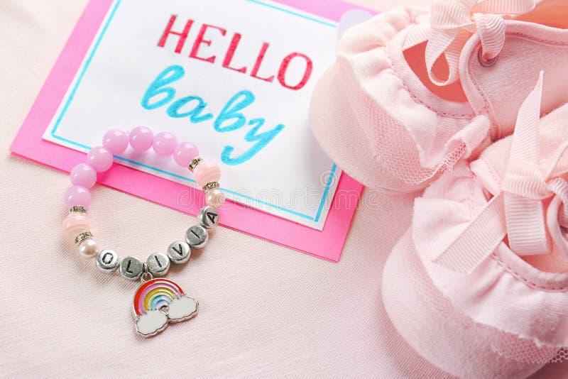 Bracelet with baby name OLIVIA stock photos