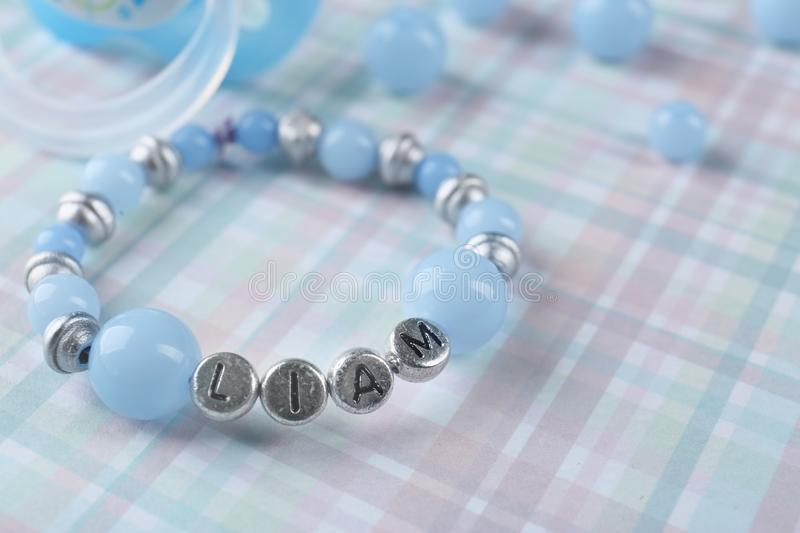 Bracelet with baby name stock image