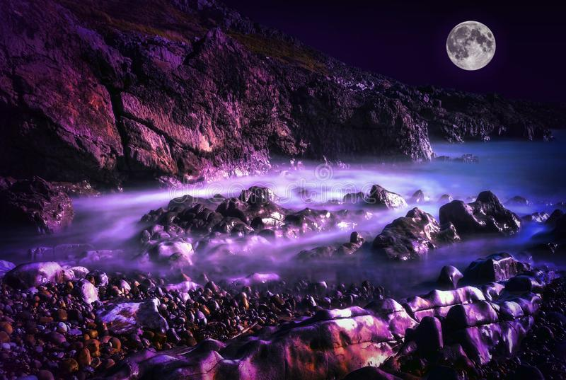Bracelet Bay Wales at night with a full moon royalty free stock photography