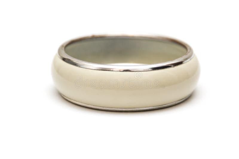 Bracelet beige d'isolement sur le blanc images stock