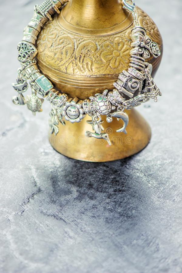 Bracelet with charms. Selective focus stock images