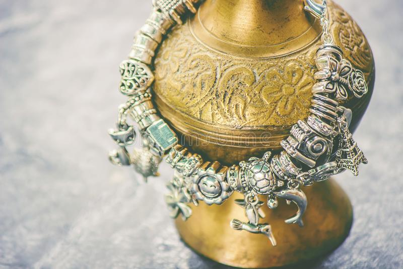 Bracelet with charms. Selective focus stock photos