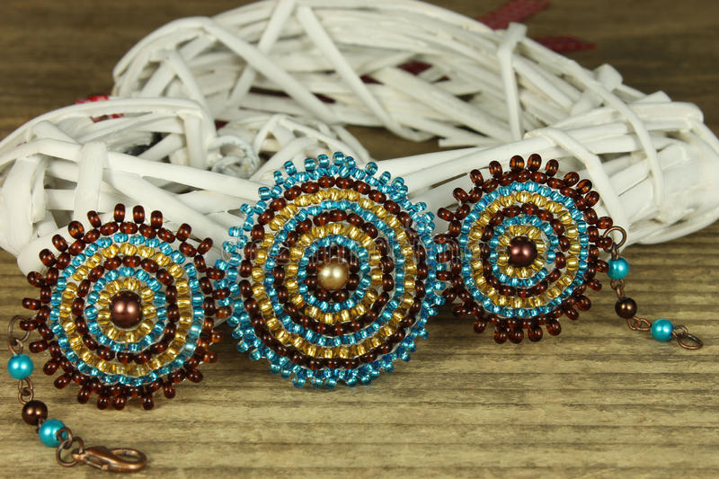 Bracelet in detail. On wooden background, blue and brown beads royalty free stock photos