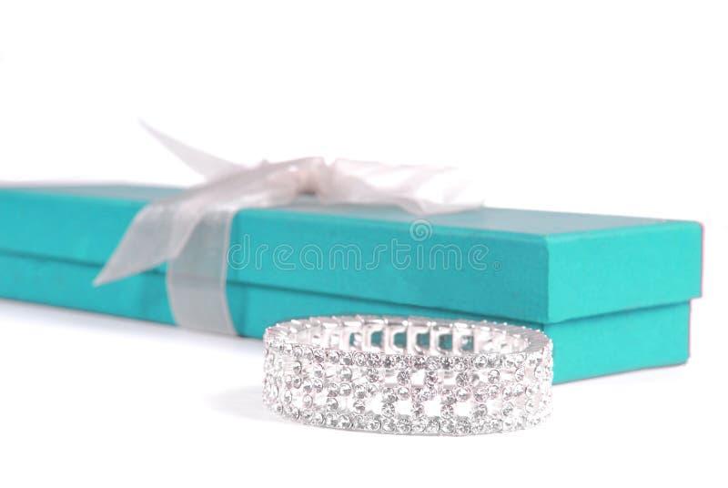 Bracelet and Gift Box. Beautiful diamond or rhinestone bracelet next to pretty turquoise gift box stock image