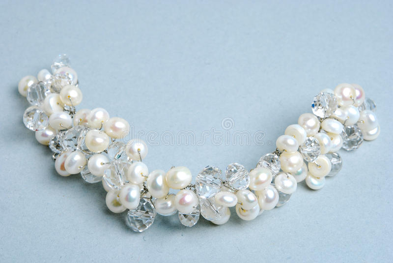 Bracelet with pearl. Bracelet with natural pearl and crystall royalty free stock images