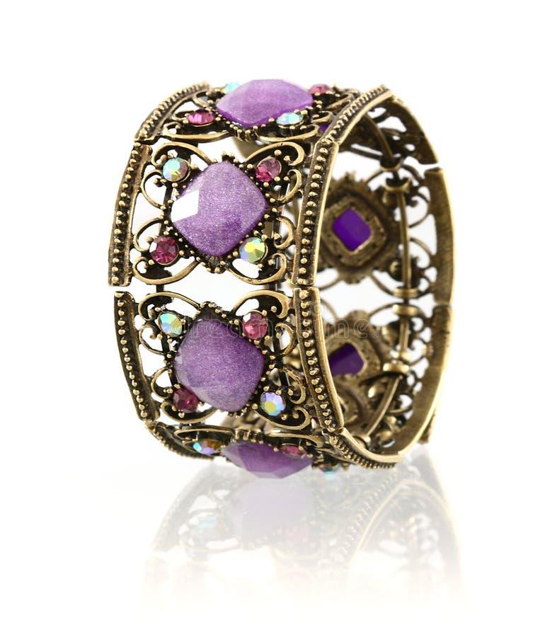 Bracelet pourpré de pierre gemme images stock