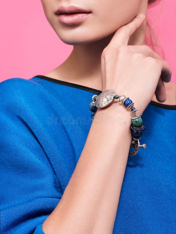 The bracelet on the wrist of a young woman. Wrist handmade bracelets royalty free stock photography