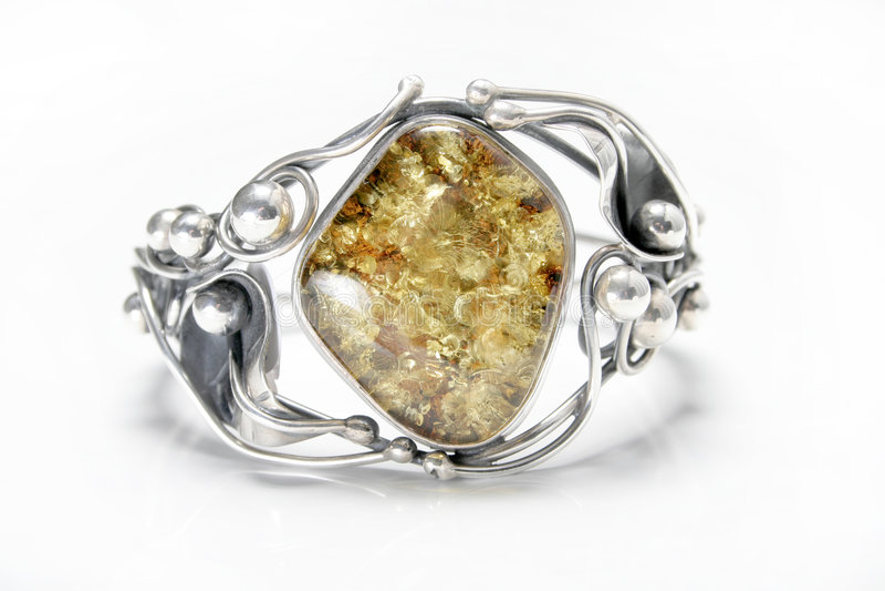 Bracelete ambarino e de prata fotos de stock royalty free