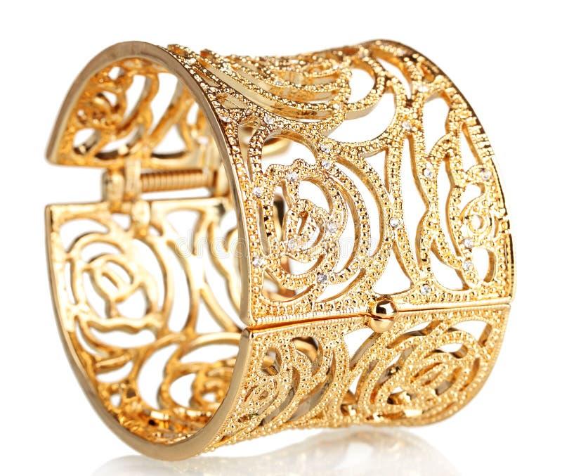 Bracelete bonito do ouro imagem de stock royalty free