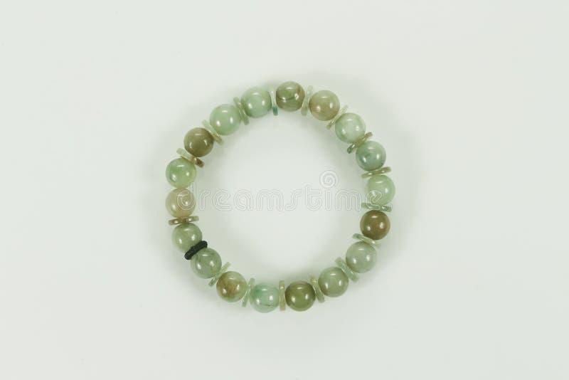 Bracelete do jade isolado em um fundo branco fotografia de stock royalty free