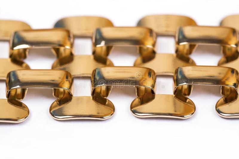 Bracelete do ouro, de aço inoxidável foto de stock