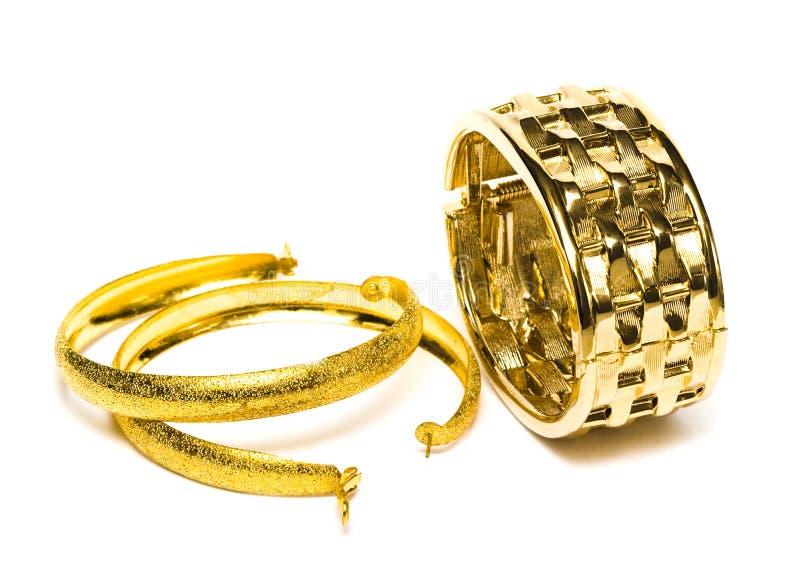 Bracelete dourado com brincos foto de stock