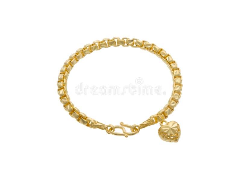 Bracelete dourado com um pendente da fôrma do coração imagens de stock