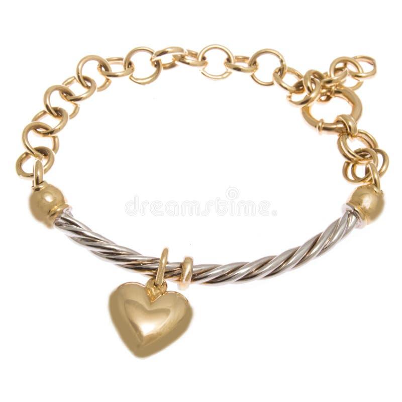 Bracelete dourado elegante com o pendente da forma do coração imagens de stock