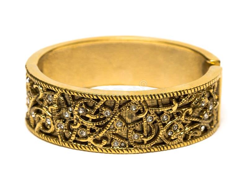Bracelete dourado isolado fotografia de stock