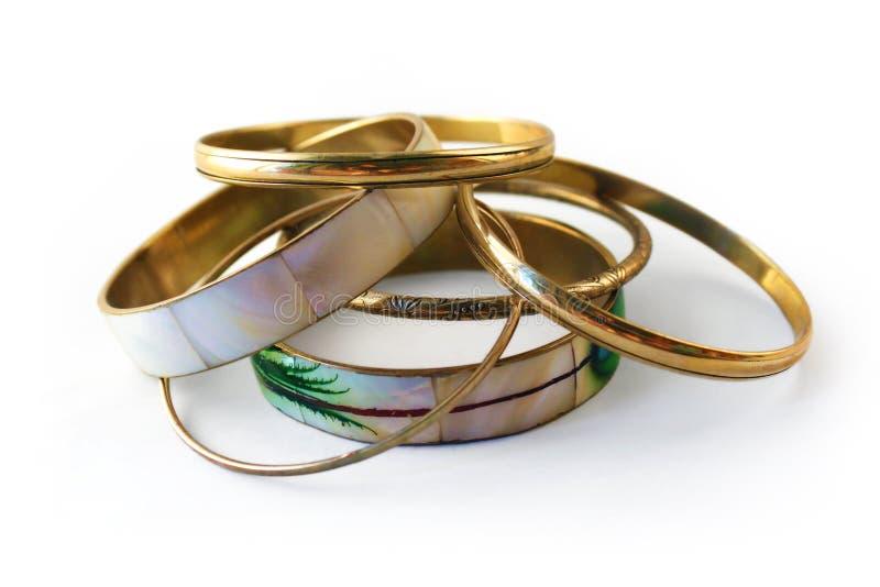Braceletes 2 do ouro imagem de stock