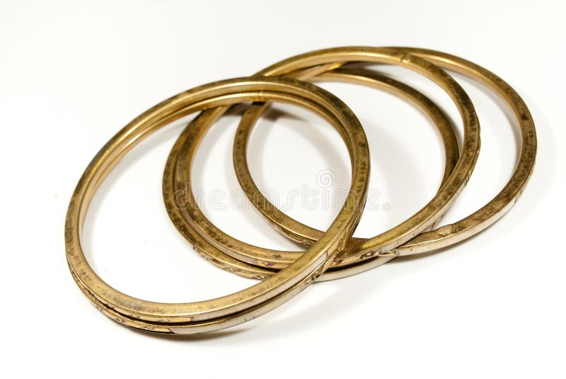 Braceletes de bronze velhos imagem de stock
