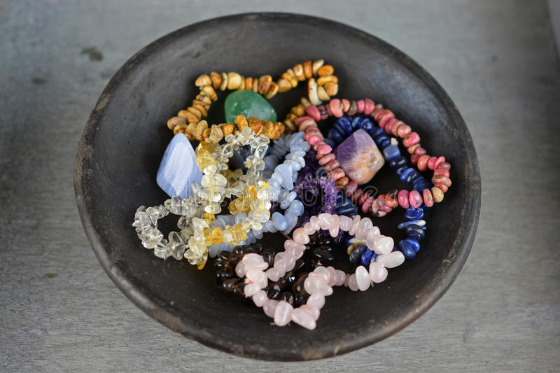 Bracelets of crystals and gemstones for a healing effect stock images