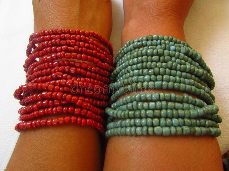 Bracelets green and red stock photos